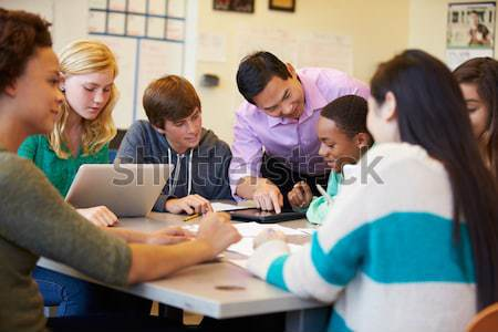 Male Pupil Studying At Desk In Classroom Stock photo © monkey_business