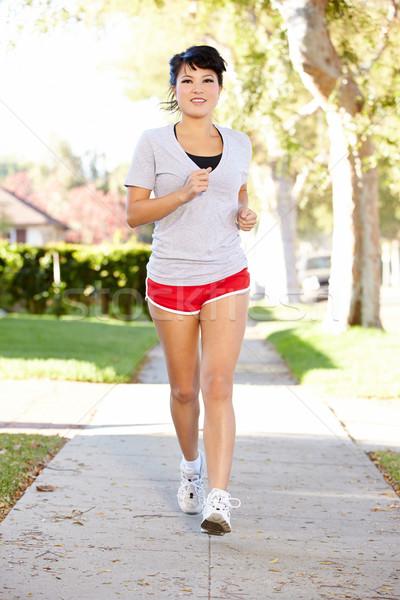 Kobiet runner podmiejski ulicy kobiet Zdjęcia stock © monkey_business