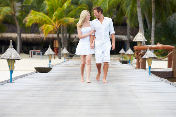 Couple Walking On Wooden Jetty Stock photo © monkey_business