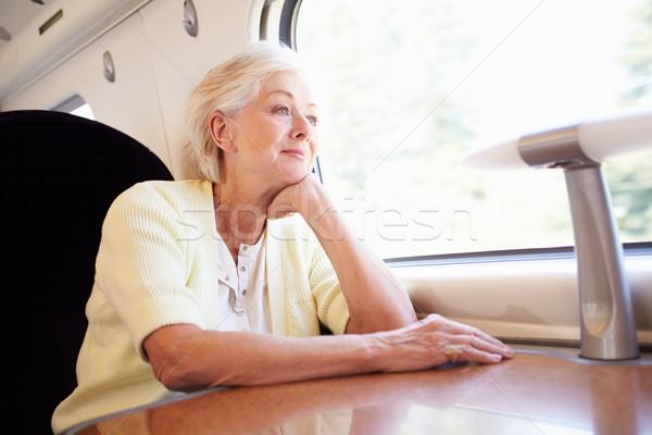 Senior Woman Relaxing On Train Journey Stock photo © monkey_business