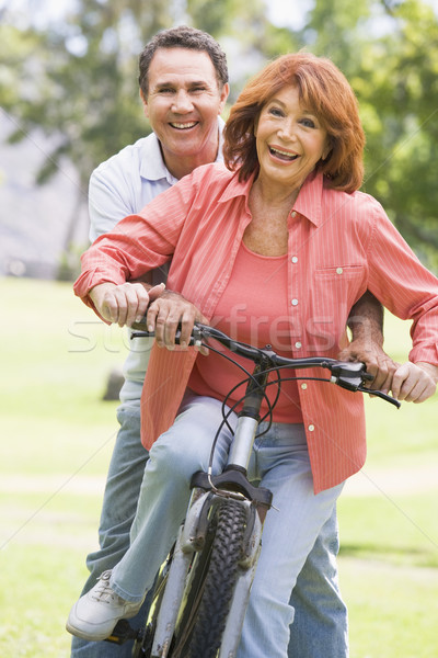 Mature couple bike riding. Stock photo © monkey_business