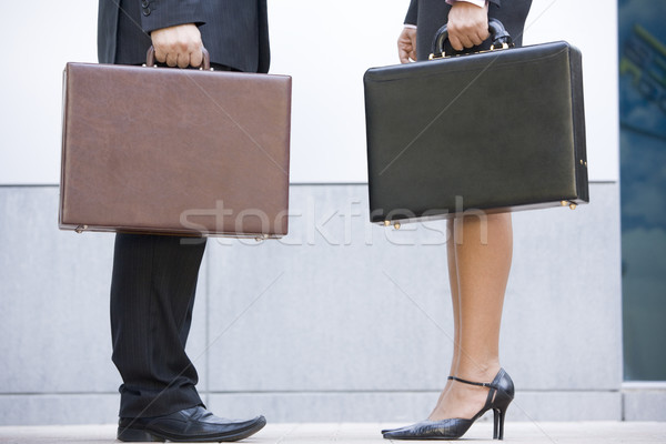 Two businesspeople holding briefcases outdoors Stock photo © monkey_business