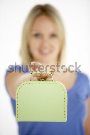 Fiatal lány tart bőrönd lány boldog mosolyog Stock fotó © monkey_business