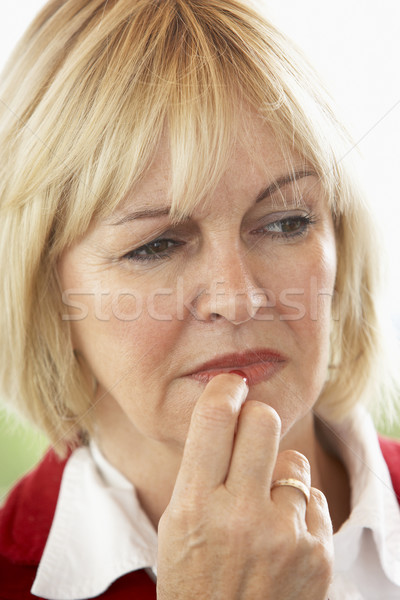 Portrait Of Middle Aged Woman Frowning Stock photo © monkey_business