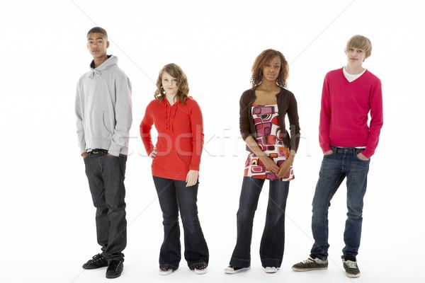 Grupo cuatro adolescentes estudio nina amigos Foto stock © monkey_business