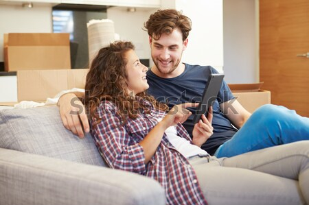 Couple Looking At Pictures On Digital Camera At Home Stock photo © monkey_business