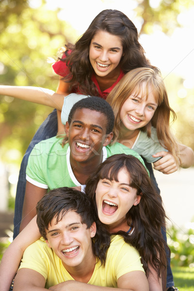 Group Of Teenagers Piled Up In Park Stock photo © monkey_business