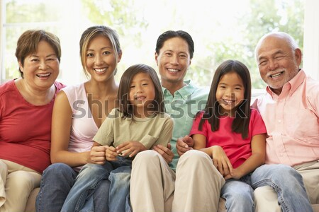 Young mixed race family embracing on beach Stock photo © monkey_business