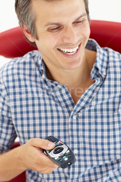 Man afstandsbediening televisie haren stoel portret Stockfoto © monkey_business