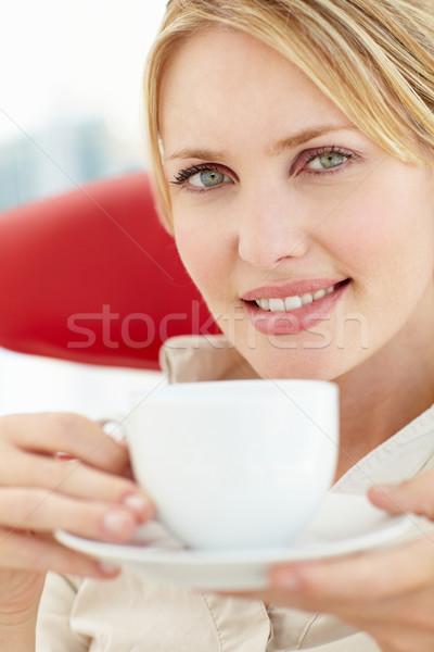 Kadın rahatlatıcı fincan çay gözler içmek Stok fotoğraf © monkey_business