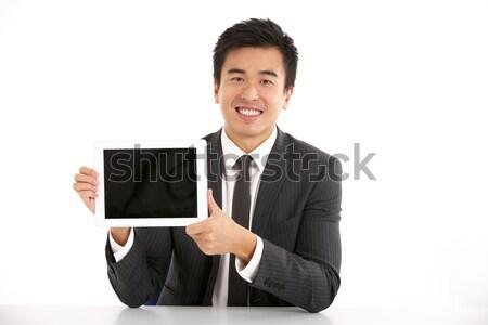 Stúdiófelvétel kínai üzletember dolgozik laptop üzlet Stock fotó © monkey_business
