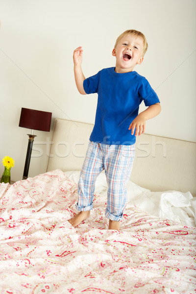 Young Boy Bouncing On Bed Stock photo © monkey_business