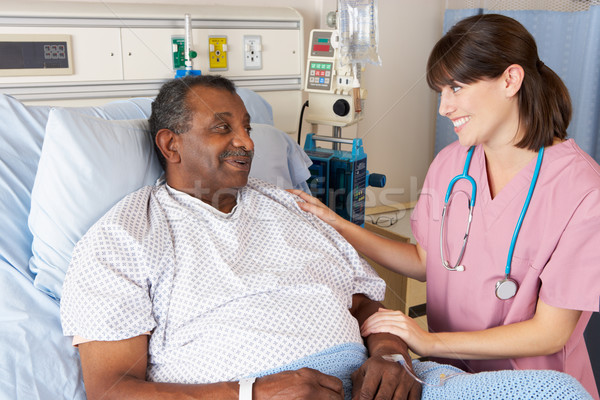 Nurse Talking To Senior Male Patient On Ward Stock photo © monkey_business