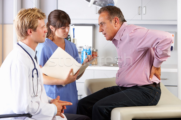 Male Patient Visiting Doctor's Office With Back Ache Stock photo © monkey_business