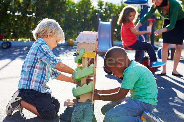 Dos ninos jugando juguete Zona de juegos nina Foto stock © monkey_business