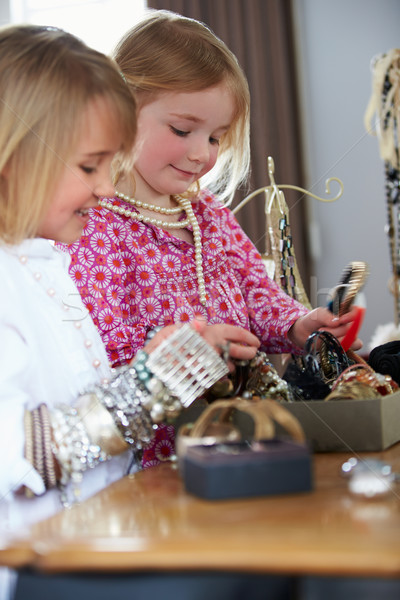 Dois meninas jogar jóias compensar menina Foto stock © monkey_business