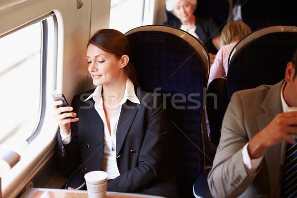 Stockfoto: Zakenvrouw · woon-werkverkeer · werk · trein · mobiele · telefoon · vrouw