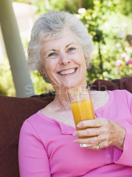 Senior woman enjoying glass of juice Stock photo © monkey_business