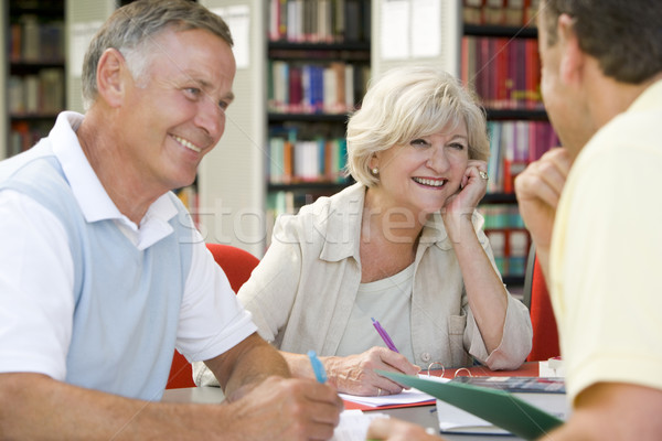 Adult students working together in a library Stock photo © monkey_business