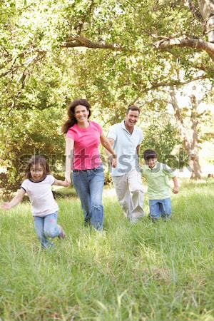 Mother and children walking along woodland path Stock photo © monkey_business