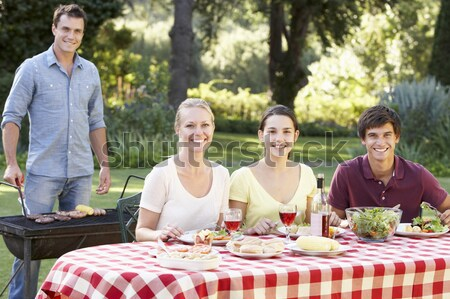 Family Enjoying A Barbeque Stock photo © monkey_business