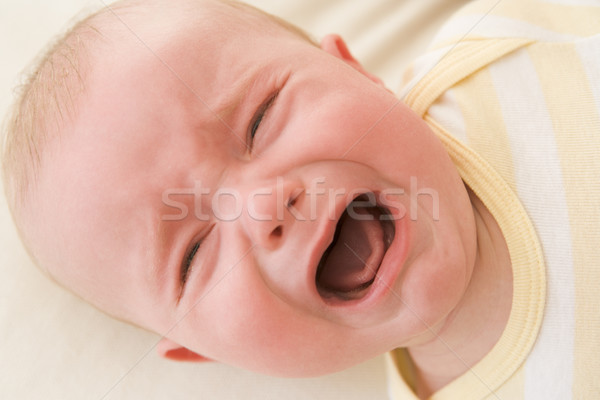 Baby lying indoors crying Stock photo © monkey_business