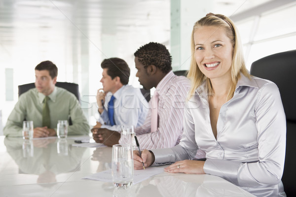 Four businesspeople in a boardroom smiling Stock photo © monkey_business