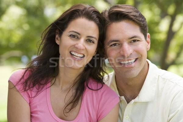 Pár kint mosolyog fű férfi mező Stock fotó © monkey_business