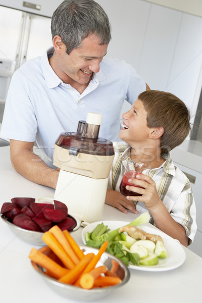Father And Son Making Fresh Vegetable Juice Stock photo © monkey_business