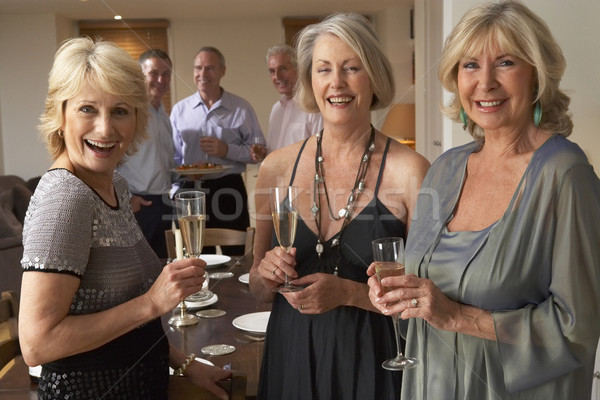 Stock photo: Friends Enjoying A Glass Of Champagne At A Dinner Party