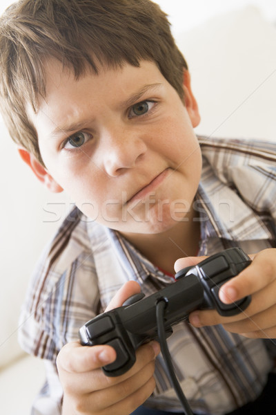 Young boy holding video game controller looking confused Stock photo © monkey_business