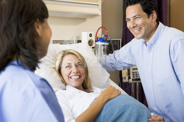 Doctor Talking To Pregnant Woman And Her Husband Stock photo © monkey_business