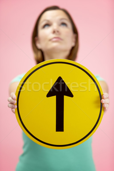 Woman Holding Road Traffic Sign Stock photo © monkey_business