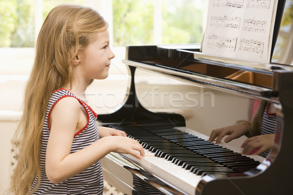 Young Girl Playing Piano Stock photo © monkey_business