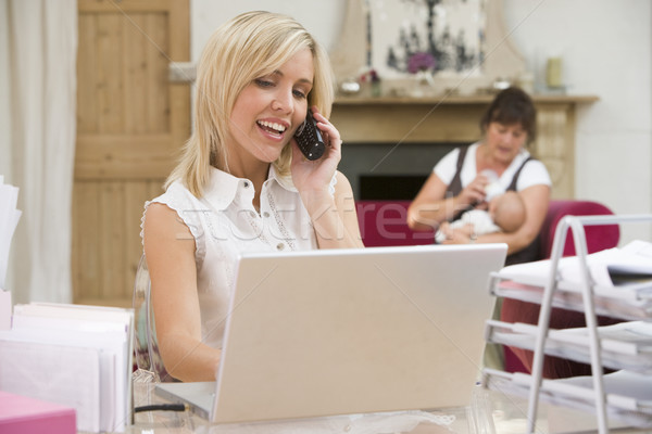 Woman in home office with laptop and telephone with mother and b Stock photo © monkey_business