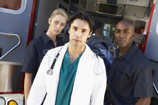Doctor and paramedics standing in front of an ambulance Stock photo © monkey_business