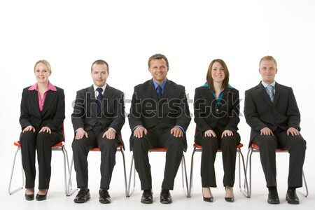 Stock photo: Group Of Business People Sitting In A Line