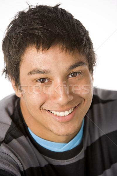 Сток-фото: портрет · цвета · подростку · улыбаясь · молодым · человеком