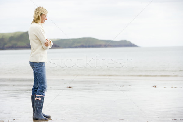 Woman standing on beach smiling Stock photo © monkey_business