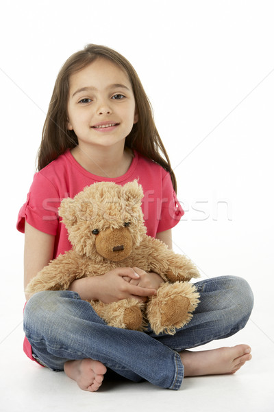 Studio Portrait Of Smiling Girl with Teddy Bear Stock photo © monkey_business