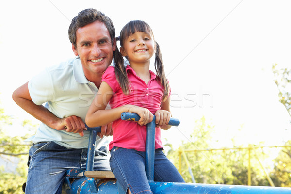 Father And Daughter Riding On See Saw In Playground Stock photo © monkey_business