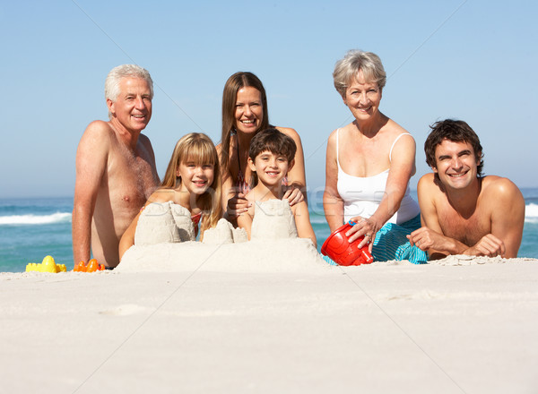 Three Generation Family Building Sandcastles On Beach Holiday Stock photo © monkey_business