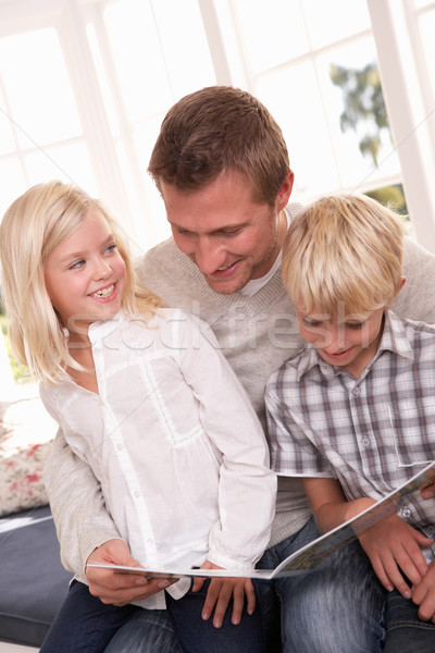 Man and children reading together Stock photo © monkey_business