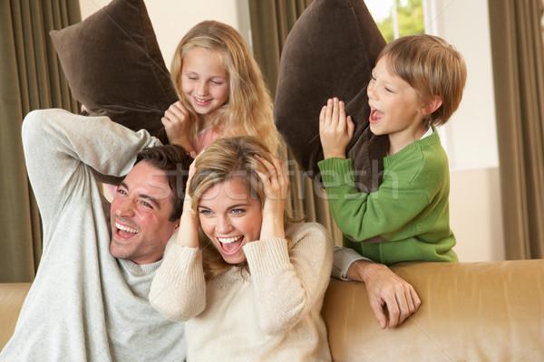 Mutlu genç aile kanepe Stok fotoğraf © monkey_business