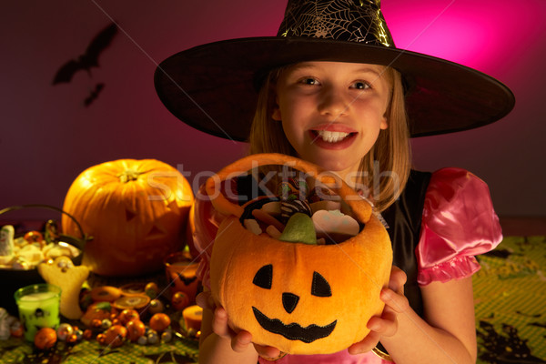 Halloween party with a child showing candy Stock photo © monkey_business