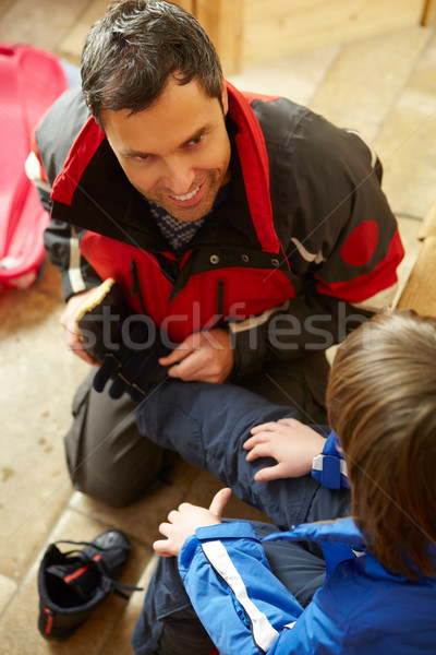 Father Helping Son To Put On Warm Outdoor Clothes And Boots Stock photo © monkey_business