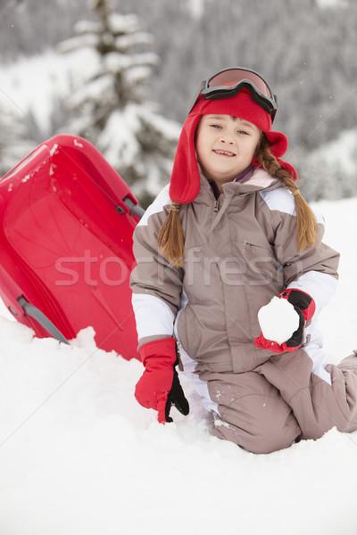 Młoda dziewczyna gry śniegu sanki narciarskie wakacje Zdjęcia stock © monkey_business