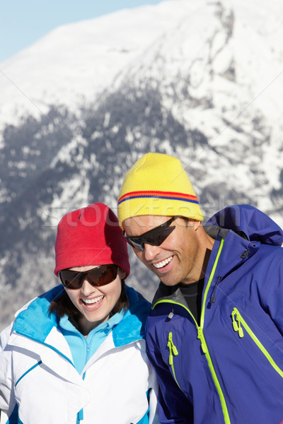 Couple Having Fun On Ski Holiday In Mountains Stock photo © monkey_business