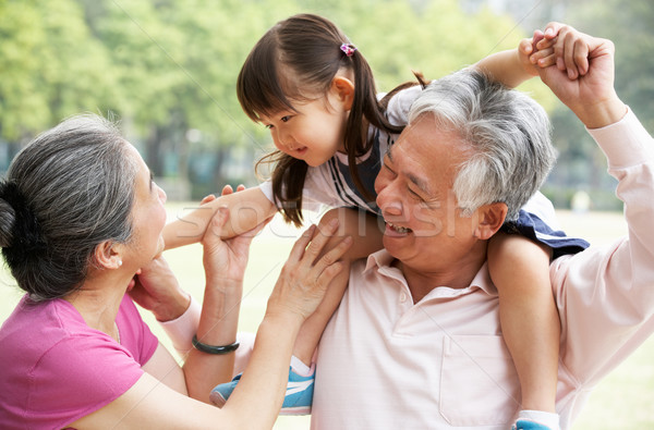 Chinese Grandparents Giving Granddaughter Ride On Shoulders Stock photo © monkey_business