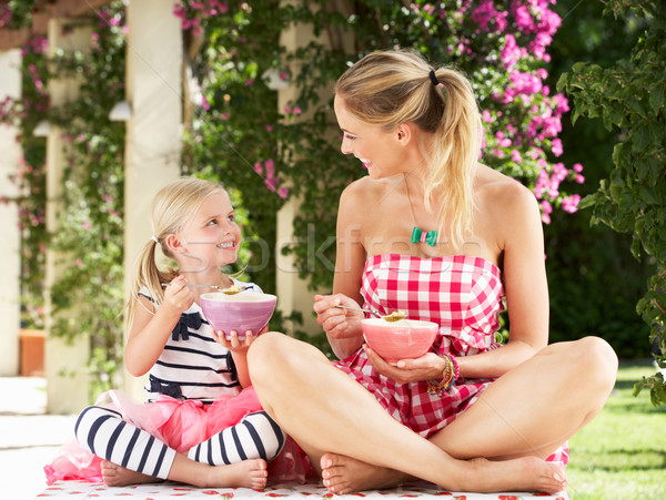 Mother And Daughter Enjoying Breakfast Cereal Outdoors Together Stock photo © monkey_business